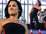 Sao Paulo, Brazil - Demi Lovato gives a few lucky fans a private performance at JK Iguatemi Mall. Wearing a black and red sleeveless jumpsuit with red pumps, she looked fierce and sexy, as usual!\nAKM-GSI         October 20, 2015\nTo License These Photos, Please Contact :\nSteve Ginsburg\n(310) 505-8447\n(323) 423-9397\nsteve@akmgsi.com\nsales@akmgsi.com\nor\nMaria Buda\n(917) 242-1505\nmbuda@akmgsi.com\nginsburgspalyinc@gmail.com