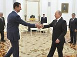 Russian President Vladimir Putin (R) shakes hands with Syrian President Bashar al-Assad during a meeting at the Kremlin in Moscow, Russia, October 20, 2015. Assad made a surprise visit to Moscow on Tuesday evening to thank Putin for launching air strikes against Islamist militants in Syria. Picture taken October 20, 2015. REUTERS/Alexei Druzhinin/RIA Novosti/Kremlin ATTENTION EDITORS - THIS IMAGE HAS BEEN SUPPLIED BY A THIRD PARTY. IT IS DISTRIBUTED, EXACTLY AS RECEIVED BY REUTERS, AS A SERVICE TO CLIENTS.     TPX IMAGES OF THE DAY