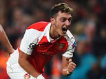 LONDON, ENGLAND - OCTOBER 20:  Mesut Oezil of Arsenal celebrates as he scores their second goal during the UEFA Champions League Group F match between Arsenal FC and FC Bayern Munchen at Emirates Stadium on October 20, 2015 in London, United Kingdom.  (Photo by Shaun Botterill/Bongarts/Getty Images)