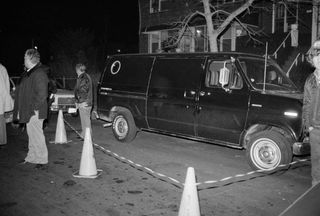 In this December 13, 1978 file photo, police cordon off an area around a stolen black van discovered in the Brooklyn after thieves who escaped with more than $6 million in cash and jewels from a JFK Airport hangar