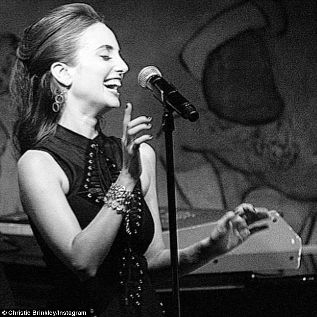Following in footsteps: Proud Christie shared an image of Alexa at the mic, which she captioned: 'What good is sitting alone in your room? Come hear the music play. Life is a Cabaret old chum, come to the Cabaret TONIGHT!