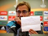 Liverpool manager Jurgen Klopp shows the media a list of injured players during a press conference at Melwood, Liverpool. PRESS ASSOCIATION Photo. Picture date: Wednesday October 21, 2015. See PA story SOCCER Liverpool. Photo credit should read: Peter Byrne/PA Wire.