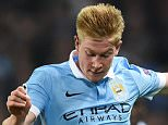 Manchester City's Belgian midfielder Kevin De Bruyne (R) is tackled by Sevilla's Spanish midfielder Vitolo during a UEFA Champions league Group D football match between Manchester City and Sevilla at the Etihad Stadium in Manchester, north west England on October 21, 2015.    AFP PHOTO / PAUL ELLISPAUL ELLIS/AFP/Getty Images