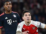 Arsenal's Spanish defender Hector Bellerin (R) vies against Bayern Munich's Brazilian midfielder Douglas Costa during the UEFA Champions League football match between Arsenal and Bayern Munich at the Emirates Stadium in London, on October 20, 2015.    AFP PHOTO / BEN STANSALLBEN STANSALL/AFP/Getty Images