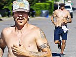 UK CLIENTS MUST CREDIT: AKM-GSI ONLY\nEXCLUSIVE: Malibu, CA - Anthony Kiedis takes a shirtless jog in Malibu. The Red Hot Chili Peppers vocalist, put his famous tattoos on display as he ran through his neighbor hood on a sunny day at the coast working up a healthy sweat.