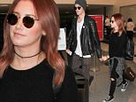 October 20, 2015: Ashley Tisdale and Christopher French depart from LAX Airport, Los Angeles, CA.\nMandatory Credit: INFphoto.com Ref.: inf-00