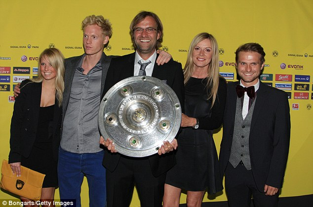 Klopp (centre) poses with his wife Ulla (second right), his son Marc (far right), his wife's son (second left) and his stepson's girlfriend (far left)
