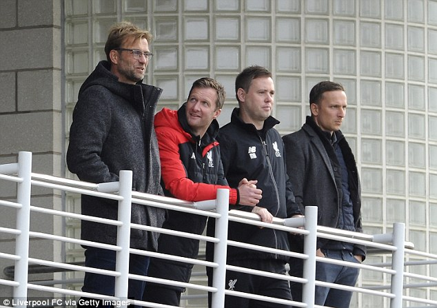 Klopp, pictured next to academy director Alex Inglethorpe, coach Michael Beale and first-team development coach Pepijn Lijnders (from left to right), attended the club's academy two days after being appointed manager