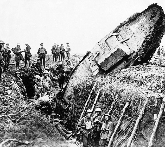 Carnage: Troops gather around a stricken tank at the Battle of Cambrai, at which Alick Cubitt was killed