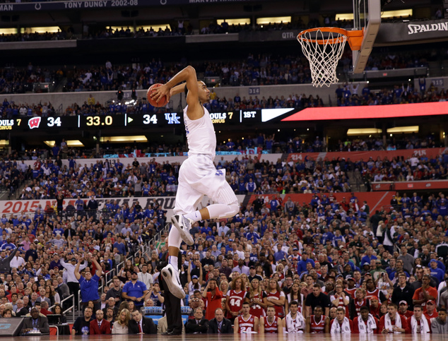 Kentucky's Trey Lyles (41) dunks the ball ahead of Wisconsin's Zak Showalter during the first half of the NCAA Final Four tournament college basketball semif...