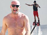 Alan Shearer spotted on the beach doing water sports while on holiday in Barbados  Ref: SPL1101285  211015   Picture by: 246paps / Splash News  Splash News and Pictures Los Angeles: 310-821-2666 New York: 212-619-2666 London: 870-934-2666 photodesk@splashnews.com