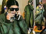 October 21, 2015: Kendall and Kylie Jenner are seen exiting their hotel, make-up free and flying out from JFK airport in New York City. Mandatory Credit: PapJuice/INFphoto.com Ref: infusny-285