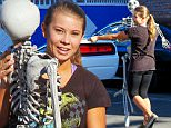 UK CLIENTS MUST CREDIT: AKM-GSI ONLY\nEXCLUSIVE: Hollywood, CA - Bindi Irwin dances with the dead ahead of Halloween week at the 'Dancing With The Stars' dance studio in Hollywood. Bindi did a short video to promote the 'DWTS' Halloween week with a plastic skeleton in the parking lot infront of fans.