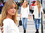 Hailey Baldwin was spotted in Soho on Thursday posing for a photoshoot for Express. She wore a stunning cutout white shirt and skinny jeans\n\nPictured: Hailey Baldwin\nRef: SPL1158375  221015  \nPicture by: 247PAPS.TV / Splash News\n\nSplash News and Pictures\nLos Angeles: 310-821-2666\nNew York: 212-619-2666\nLondon: 870-934-2666\nphotodesk@splashnews.com\n