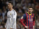 """Barcelona's Argentinian forward Lionel Messi (R) stands past Real Madrid's Portuguese forward Cristiano Ronaldo during the """"El clasico"""" Spanish League football match between Real Madrid and Barcelona at the Santiago Bernabeu stadium in Madrid, Spain on March 23, 2014.  Barcelona won 4-3.     AFP PHOTO/ DANI POZO         (Photo credit should read DANI POZO/AFP/Getty Images)"""