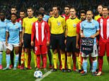 MANCHESTER, ENGLAND - OCTOBER 21: The players and match officials pose with No to Racism pennants during the UEFA Champions League Group D match between Manchester City and Sevilla at Etihad Stadium on October 21, 2015 in Manchester, United Kingdom.  (Photo by Alex Livesey/Getty Images)