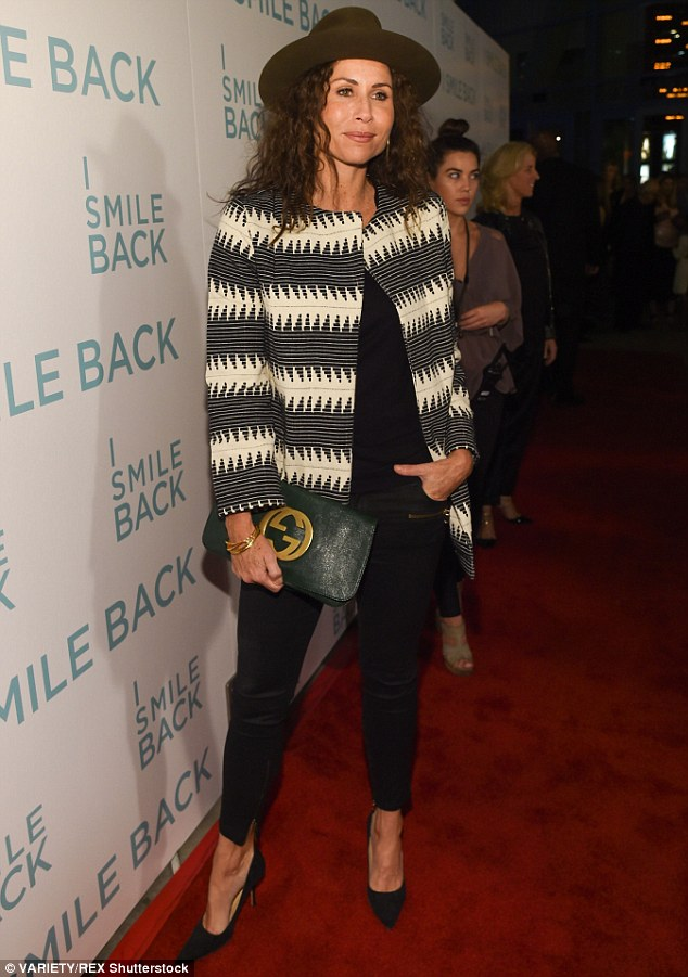 Hats the way to do it:Making a bold yet stylish statement by teaming a jazzy jacket and olive fedora, the 45-year-old actress cut a chic figure as she arrived at the glitzy screening