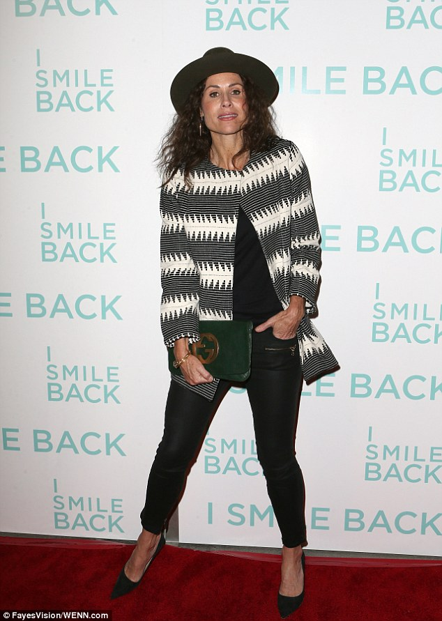 Fashionable film star: Teaming the jacket with a pair of fitted black trousers and stiletto heels, the English rose showcased her toned and lithe legs
