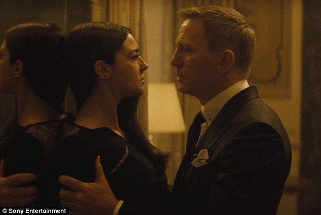 He's back: Daniel Craig is seen in a brand new teaser clip for Spectre with Monica Bellucci, the two stars getting intimate in a steamy clinch