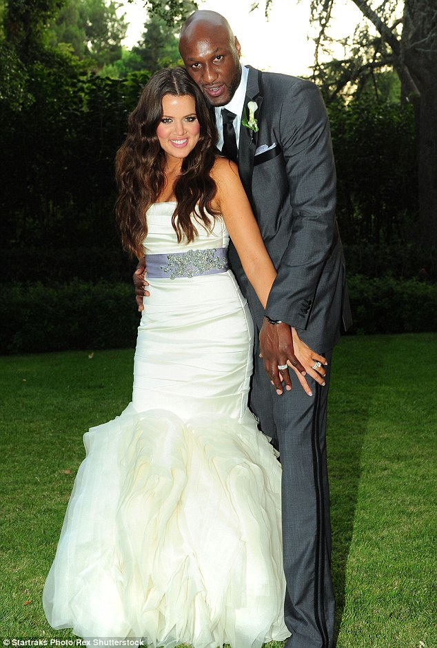Digging up the past: Khloe describes how she got over her heartbreak after her split with husband Lamar Odom in her new tell-all memoir. She credits the basketball star at the end of the tome saying 'Before you I was invisible'. The couple married in 2009 (pictured)