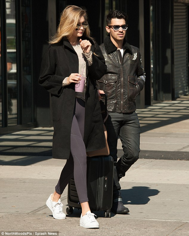 Time to say goodbye:Gigi Hadid, 20, showed off her enviable figure in grey leggings as she strolled out of her New York hotel with boyfriend Joe Jonas, 26, on Thursday