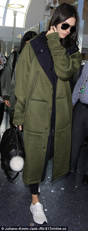 Wrapping up: Kendall was clad in an olive-green coat over a black T-shirt and matching leggings