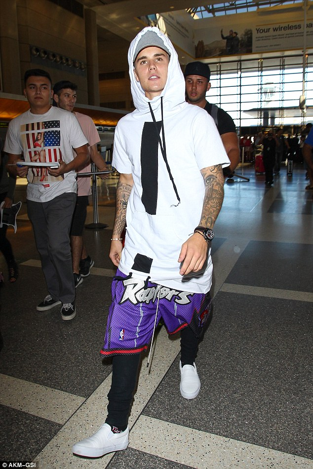 When in doubt, wear everything: Justin appeared to be making sure he wasn't going to leave any look uncovered with his outfit as he passed through LAX on Tuesday night for his flight