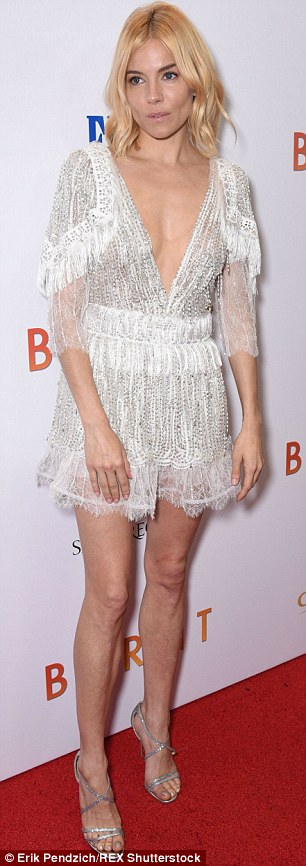 Stunning: Sienna showed off her slender figure in a Rodarte S/S 2016 white dress with heavy embellishments and sheer panels