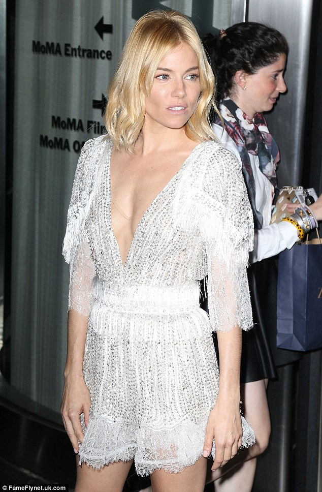 Seriously sexy: Sienna was a gorgeous addition to premiere proceedings, showing off her little white dress from all angles for maximum effect