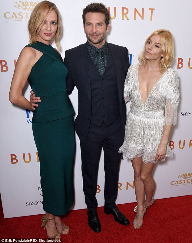 A lot on his plate: Smug Bradley was revelling in the fact he had beauties Uma Thurman and Sienna on his arm