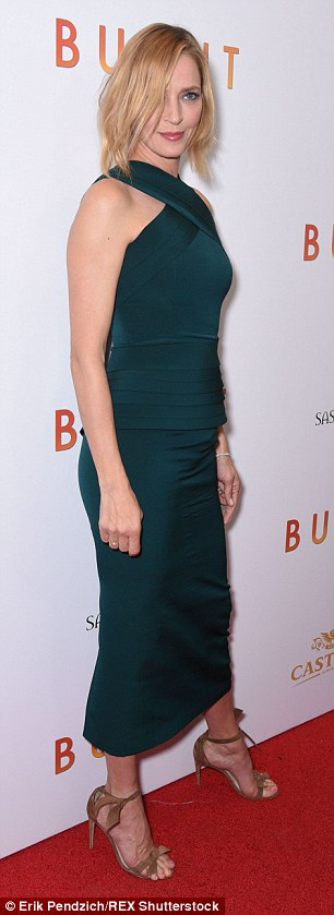 Green with envy: Uma, 45, cut an almost otherworldy figure in her tight teal dress on the red carpet