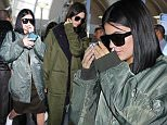 Wednesday, October 21, 2015 - Kendall and Kylie Jenner return from New York to Los Angeles after celebrating the launch of the Balmain x H&M collection.  The sisters rushed back to half-sister Khloe's side to support her as she monitors Lamar Odom's recover. The girls wore matching army green - Kylie's $1000 R13 oversided bomber and Kendall's Y3 duster made a fashion statement!\nJuliano-KMM-Jack-RS/X17online.com