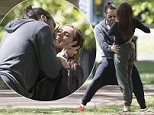 EXCLUSIVE.. Mandatory Credit: Photo by Simon Runting/REX Shutterstock (5249505l).. Russell Brand.. Russell Brand out and about, Auckland, New Zealand  - 15 Oct 2015.. Russell Brand out for a walk in Victoria Park in Auckland has a bizarre meeting with an attractive fan where he appears to either write something or look at a tattoo on her back then poses for pics...