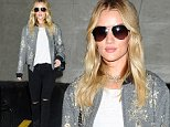Mandatory Credit: Photo by Startraks Photo/REX Shutterstock (5288029g)\n Rosie Huntington-Whiteley\n Rosie Huntington-Whiteley at LAX international airport, Los Angeles, America - 21 Oct 2015\n Rosie Huntington-Whiteley Arriving at Lax Airport\n