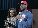 First lady Michelle Obama looks at Cleveland Cavaliers' basketball player LeBron James as he speaks at The University of Akron, Wednesday, Oct. 21, 2015, in Akron, Ohio. James teamed up with Mrs. Obama to celebrate the importance of secondary education at a private event at the University of Akron. The NBA superstar, who went from high school to the pros, and first lady are hosting thousands of children and their parents at the school. (AP Photo/Tony Dejak)