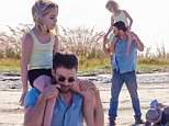 UK CLIENTS MUST CREDIT: AKM-GSI ONLY\nEXCLUSIVE: Tybee Island, GA - Chris Evans holds co-star Mckenna Grace on his shoulders as they film a scene for 'Gifted' in Tybee Island, Georgia.