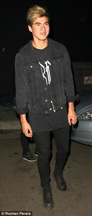 Too young: Calum Hood (left) and Luke Hemmings' night appeared to end early after they were spotted leaving the popular venue