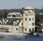 FILE - This Jan. 7, 2007 file photo shows the home of Ed and Elaine Brown in Plainfield, N.H.  The property, owned by convicted tax evaders, will once again be auctioned for sale Oct. 22, 2015.  (AP Photo/Jim Cole, File)