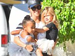 Kourtney Kardashian carries North and Penelope to dance class in studio city  Pictured: Kourtney Kardashian, North West, Penelope Disick Ref: SPL1157144  211015   Picture by: Fern / Splash News  Splash News and Pictures Los Angeles: 310-821-2666 New York: 212-619-2666 London: 870-934-2666 photodesk@splashnews.com