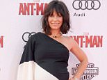 """HOLLYWOOD, CA - JUNE 29:  Actress Evangeline Lilly arrives at the premiere of Marvel Studios """"Ant-Man"""" at Dolby Theatre on June 29, 2015 in Hollywood, California.  (Photo by Gregg DeGuire/WireImage)"""