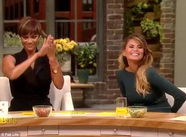 Beaming: The model couldn't stop smiling as Tyra announced the news to everyone