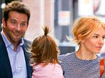 """20.OCT.2015- NEW YORK CITY - USA ***AVAILABLE FOR UK AND GERMANY SALE ONLY *** **EXCLUSIVE ALL ROUND PICTURES** SIENNA MILLER CARRIES HER DAUGHTER MARLOWE IN HER ARMS AS SHE LEAVES HER HOTEL WITH """"BURNT"""" CO-STAR BRADLEY COOPER TO HOP IN A WAITING SUV.  BRADLEY CAN BE SEEN MAKING FUNNY FACES AT LITTLE MARLOWE AS THE PAIR WALKED OUTSIDE OF THEIR HOTEL. BYLINE MUST READ: XPOSUREPHOTOS.COM ***UK CLIENTS - PICTURES CONTAINING CHILDREN PLEASE PIXELATE FACE PRIOR TO PUBLICATION *** *UK CLIENTS MUST CALL PRIOR TO TV OR ONLINE USAGE PLEASE TELEPHONE 0208 344 2007*"""