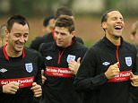 England footballer Rio Ferdinand (C) laughs as he trains with team-mates at the London Colney training ground, on October 8, 2010. England are set to play Montenegro in a Euro 2012 qualifying match on October 12 at Wembley. AFP PHOTO/GLYN KIRK NOT FOR MARKETING OR ADVERTISING USE/RESTRICTED TO EDITORIAL USE (Photo credit should read GLYN KIRK/AFP/Getty Images)