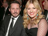 FILE - Kelly Clarkson Announces She Is Pregnant With Her Second Child On Stage During A Concert In LA LOS ANGELES, CA - FEBRUARY 10:  Singer Kelly Clarkson (R) and Brandon Blackstock attend the 55th Annual GRAMMY Awards at STAPLES Center on February 10, 2013 in Los Angeles, California.  (Photo by Christopher Polk/Getty Images for NARAS)