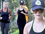 """Brentwood, CA - """"Legally Blonde"""" beauty Reese Witherspoon makes time for her workouts as she goes jogging in Brentwood with a friend.  The petite actress wore a pair of sunglasses and kept her face shielded in a black hat. \nAKM-GSI           October 23, 2015\nTo License These Photos, Please Contact :\nSteve Ginsburg\n(310) 505-8447\n(323) 423-9397\nsteve@akmgsi.com\nsales@akmgsi.com\nor\nMaria Buda\n(917) 242-1505\nmbuda@akmgsi.com\nginsburgspalyinc@gmail.com"""