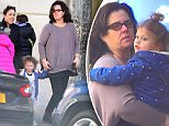 EXCLUSIVE: Rosie O'Donnell was spotted being a happy mother as she stepped out with daughter, Dakota, 2, in NYC. She carried her young daughter, just days after winning Joint custody of her, after a nasty divorce battle with ex Michelle Rounds. They were spotted out in NYC while Rosie ran some errands.\n\nPictured: Rosie O'Donnell , Dakota\nRef: SPL1159547  231015   EXCLUSIVE\nPicture by: 247PAPS.TV / Splash News\n\nSplash News and Pictures\nLos Angeles: 310-821-2666\nNew York: 212-619-2666\nLondon: 870-934-2666\nphotodesk@splashnews.com\n