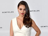 LONDON, ENGLAND - JUNE 23:  Actress and Gemfields brand ambassador, Mila Kunis, attends a photocall for the launch of Gemfields Mozambican rubies in London at Corinthia Hotel London on June 23, 2015 in London, England. Mila steps out in two pieces from Faberge's Devotion collection, including a pair of earrings set with diamonds and 10 oval Mozambican rubies totalling 9.32 carats and a ring set with diamonds and a single 5 carat oval Mozambican ruby. In addition, Mila wore the Faberge Regalia diamond and ruby bracelet set with 176 Mozambican rubies totalling over 17 carats.  (Photo by Karwai Tang/WireImage)