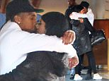 Kylie Jenner and Tyga shared a hug and a kiss outside the Beverlu Hills Hotel.  Kylie wore a long coat, while Tygawent with dark jeans and a sweatshirt, on Thursday, October 22, 2015  X17online.com