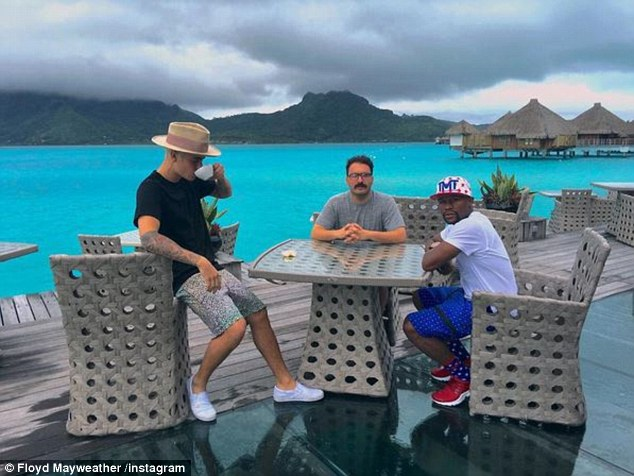 Earlier this month Mayweather went on holiday with popstar Justin Bieber (left) in the French Polynesia