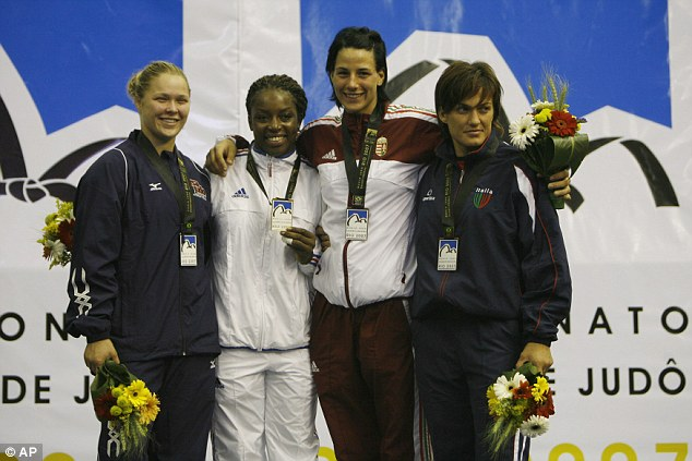 Rousey poses with her silver medal alongside other competitors in the 70kg category at the World Judo Championships in Rio de Janeiro in 2007